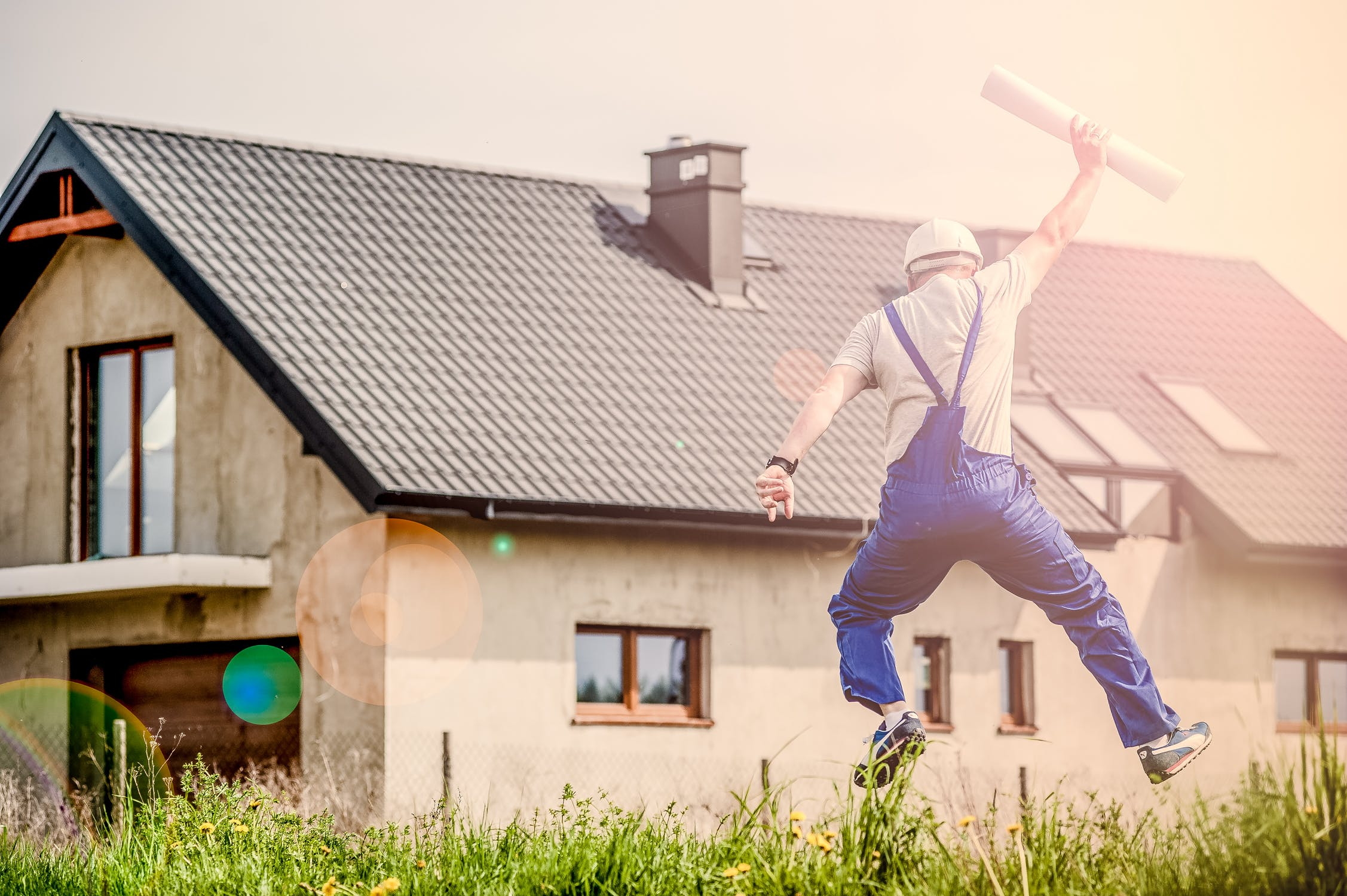 Man celebrating as he builds his new home